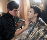 Eddie applying makeup to his model during the show's taping
