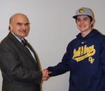 OF Xavier Rivera shakin hands