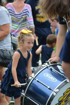 young girl playing drums with OFHS band