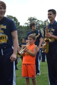 youngster playing trumpet with OFHS band