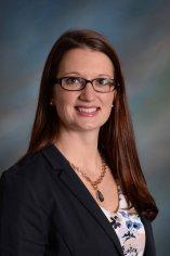 Photo of OFCS Treasurer/CFO Ms. Emily Dales