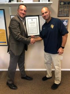 Dr. Jim Lloyd presents award to Mr. John Vas